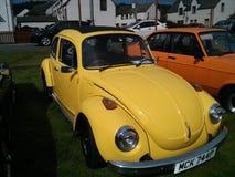 Annata gialla Volkswagen Beetle di VW Fotografia Stock Libera da Diritti
