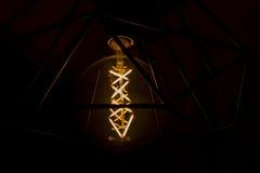 Annata illuminata nel fondo scuro Fotografia Stock