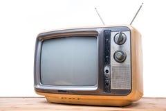Annata TV sulla tavola di legno Fotografie Stock Libere da Diritti
