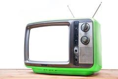 Annata verde TV sulla tavola di legno Fotografia Stock