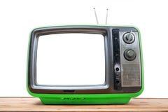 Annata verde TV sulla tavola di legno Immagine Stock