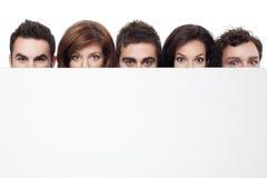 Anúncio com faces engraçadas Fotos de Stock Royalty Free