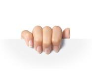 Anúncio. preensão da mão em um papel Imagens de Stock Royalty Free