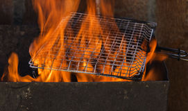 Annealing grille grilling on an open fire Stock Photos