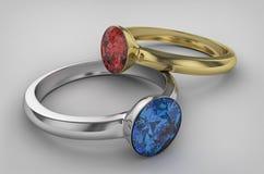 Anneau avec le diamant bleu et rouge Photographie stock