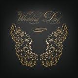 Anneaux de mariage et ailes ornementales Image stock