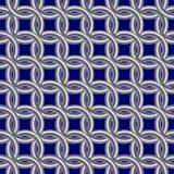 Anneaux en métal sur un fond bleu-foncé Images libres de droits