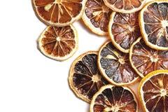 Anneaux secs de citron d'isolement sur le blanc photographie stock libre de droits