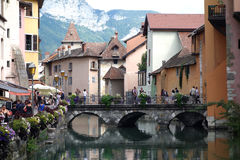 Annecy, France. Bridge in Annecy, France. Water reflection, people having lunch Stock Image