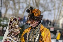 Disguised Couple - Annecy Venetian Carnival 2013. Annecy, France, February 24, 2013: A disguised couple posing in Annecy, France, during a Venetian Carnival Royalty Free Stock Photos