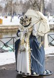 Disguised Person - Annecy Venetian Carnival 2013. Annecy, France, February 24, 2013: Image of a disguised person posing in Annecy, France, during a Venetian Royalty Free Stock Photography
