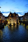 Annecy, France - JUNE 19, 2015 People relaxing, walking, and eating around Palace of the Isle and river Thiou Royalty Free Stock Photos