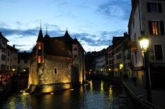 Annecy, France - JUNE 19, 2015 People relaxing, walking, and eating around Palace of the Isle and river Thiou Stock Images