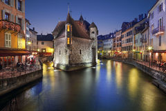 Annecy, France. The old prison in Annecy, the Palais de lisle, at dusk Stock Photo