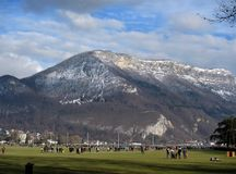Annecy France winter mountains view and cloudy sky stock images