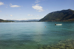 Annecy lake and anchored motor boat Royalty Free Stock Image