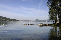 Annecy lake on morning with pontoons Stock Images