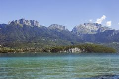 Annecy lake and mountains. Lake of Annecy and mountains La Forclaz and Tournette Stock Photos