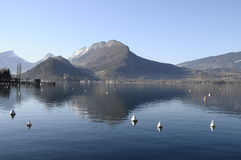 Annecy lake, mountains and reflection Royalty Free Stock Image