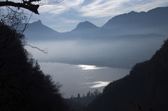 Annecy lake and mountains silhouettes Stock Photography