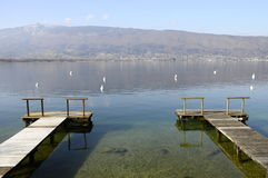 Annecy lake and mountains from two wooden pontoons Stock Photography