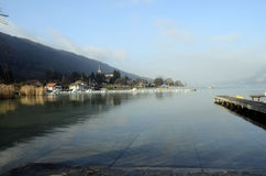 Annecy lake and snow, winter, france royalty free stock photo