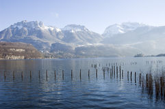 Annecy lake and snowed mountains Royalty Free Stock Image