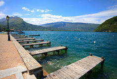 Annecy lake, wooden pontoons andlanding stage in Veyrier-du-lac. Royalty Free Stock Images
