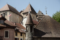 Annecy. Roofs and towers of historical buildings in town Annecy royalty free stock images