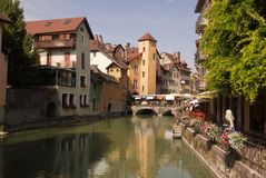 AnnecyRiver. Town of Annecy France on a Sunday, market day. The Thiou river and reflections presented a balance that was pleasing to my eye Royalty Free Stock Image