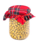 Сanned peas. In a glass jar with a fabric roof isolated on white Royalty Free Stock Image