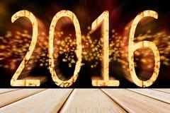 2016 anni con la parete scintillante del bokeh ed il pavimento di legno Fotografie Stock