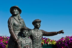 The Annie Moore Memorial. Statue of Annie Moore and her two Brothers in Cobh, Ireland (Annie was the first immigrant to the United States to pass through the Royalty Free Stock Photos