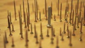 Annihilation concept, hand knocks over hundreds of upright screws, slow motion close up