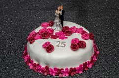 Anniversary cake with bride and groom for silver wedding royalty free stock image