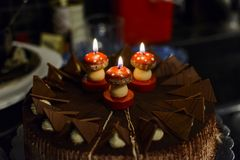 Anniversary cakes. Anniversary chocolate cakes with Mushroom candles in a dark place Royalty Free Stock Photo