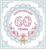 Anniversary card 60 years. Anniversary card with 60 years in a frame with an ornament and flowers Stock Photo