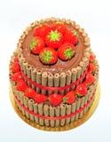 Anniversary chocolate cake decorated with fresh strawberries Stock Photos