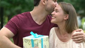 Anniversary congratulations from wife to husband, present box, happily married. Stock footage stock video