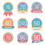 Anniversary Emblems. Set of round anniversary emblems with ribbons Royalty Free Stock Photography