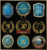Anniversary gold and blue labels collection, 20 years Royalty Free Stock Photography
