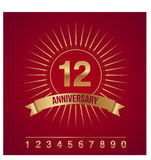 Anniversary gold emblem/icon with rays and all num Royalty Free Stock Image