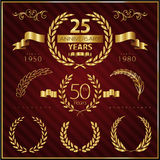 Anniversary golden emblems and decorative elements Stock Image