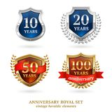 Anniversary golden heraldic labels set Stock Photography