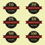 Anniversary label set. Anniversary years label set. Black labels with red ribbons Stock Image