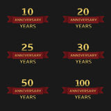 Anniversary label set. Anniversary years label set. Golden labels with red ribbons Royalty Free Stock Image