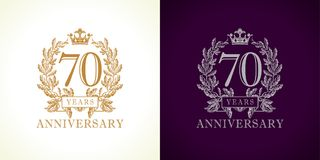 70 anniversary luxury logo. 70 years old luxurious logotype. Congratulating 70th numbers gold colored template framed in palms. Isolated greetings celebrates Royalty Free Stock Image
