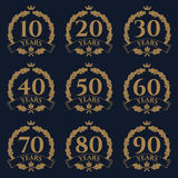 10-100 anniversary oak wreath icon. 10-100 anniversary gold oak wreath icon on blue background. Vector design element Royalty Free Stock Image