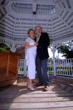 Anniversary party. A senior couple dancing during an anniversary or wedding party in a gazebo Stock Photos