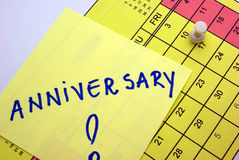Anniversary Post it. With pushpin on a yellow calendar Stock Photography
